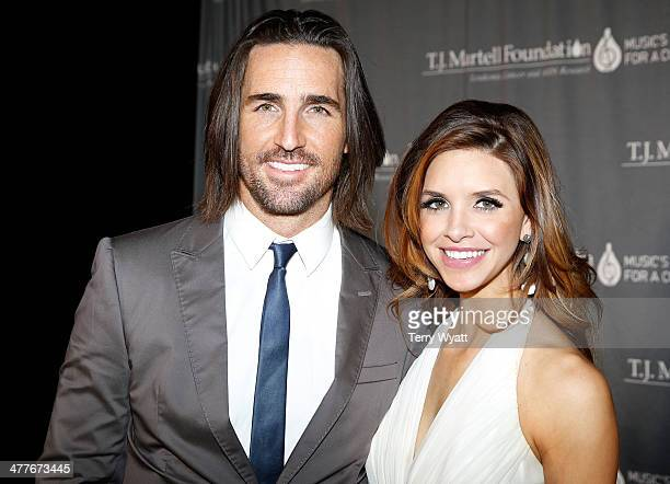 Musician Jake Owen and Lacey Buchanan attend the TJ Martell Foundation Nashville Honors Gala at the Omni Hotel on March 10 2014 in Nashville Tennessee