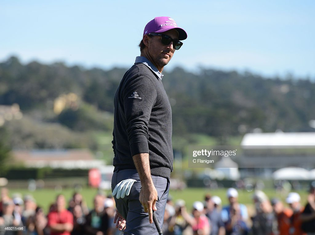 Musician Jake Owen waits on the 18th green during the 3M Challenge before the AT&T Pebble Beach National Pro-Am at the Pebble Beach Golf Links on February 11, 2015 in Pebble Beach, California.