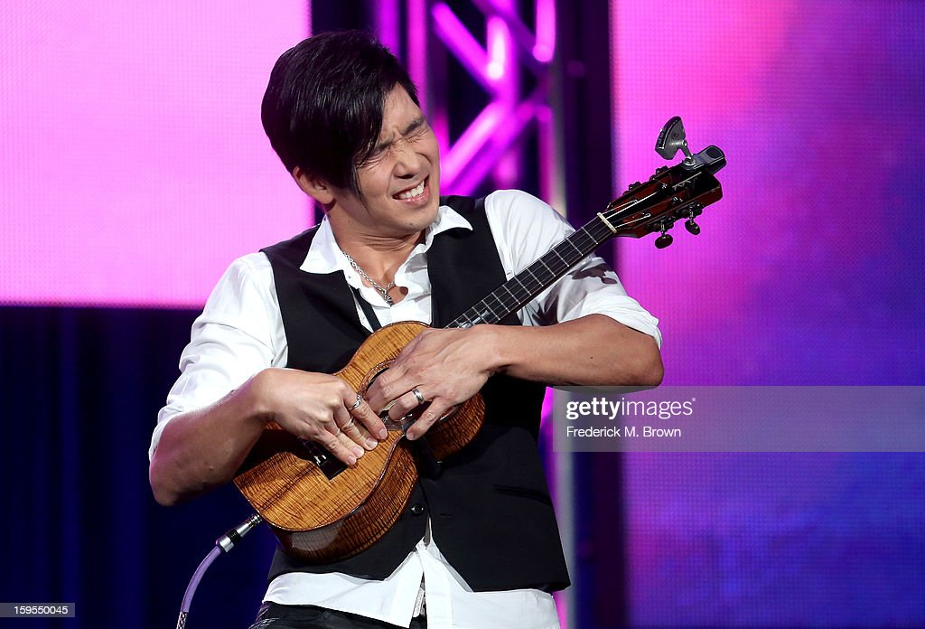 Musician <a gi-track='captionPersonalityLinkClicked' href=/galleries/search?phrase=Jake+Shimabukuro&family=editorial&specificpeople=2610009 ng-click='$event.stopPropagation()'>Jake Shimabukuro</a> performs onstage during 'The Life On Four Strings' Panel discussion at the PBS Portion- Day 2 of the 2013 Winter Television Critics Association Press Tour at Langham Hotel on January 15, 2013 in Pasadena, California.