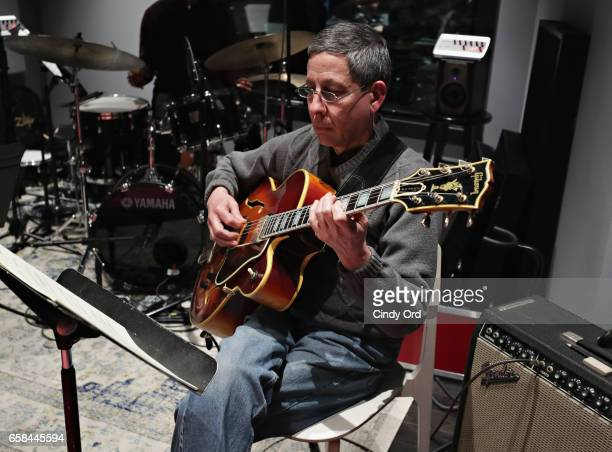 Musician James Chirillo plays guitar as Wynton Marsalis and Jon Batiste perform the music of John Lewis at Spotify Studio for Jazz at Lincoln...