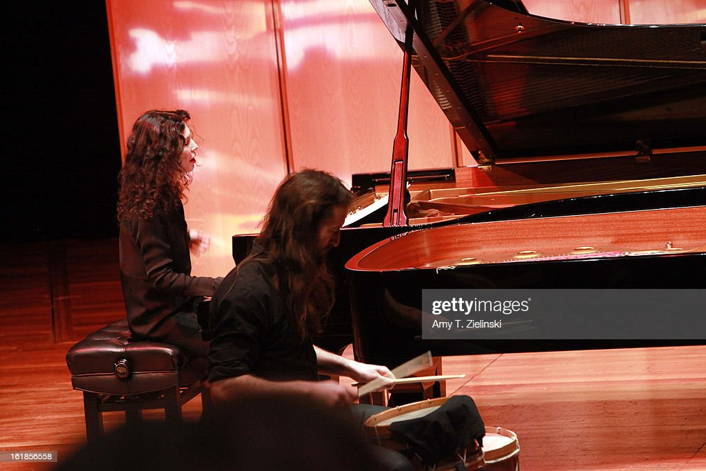 Musician Jamixel Bereau (R) of the Kalakan Trio performs on his percussion instrument during a recital with French sisters, concert pianists <a gi-track='captionPersonalityLinkClicked' href=/galleries/search?phrase=Katia+Labeque&family=editorial&specificpeople=5796021 ng-click='$event.stopPropagation()'>Katia Labeque</a> (L) and Marielle Labeque for Ravel's 'Bolero' arrangement for duo piano as part of 'Imagine' family concerts programming at the Queen Elizabeth Hall on February 17, 2013 in London, England.