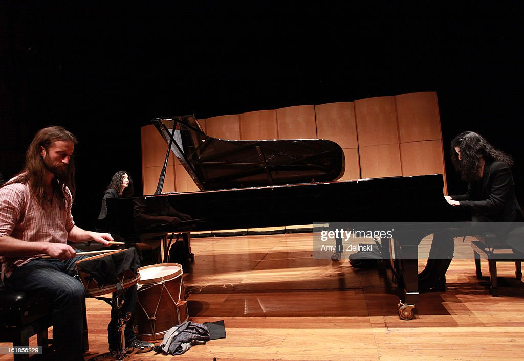 Musician Jamixel Bereau of the Kalakan Trio practices his percussion instruments during rehearsal with French sisters, concert pianists Katia Labeque (L) and Marielle Labeque (R) for Ravel's 'Bolero' arrangement for duo piano as part of 'Imagine' family concerts and also the 'The Rest Is Noise' programming at the Queen Elizabeth Hall on February 17, 2013 in London, England.