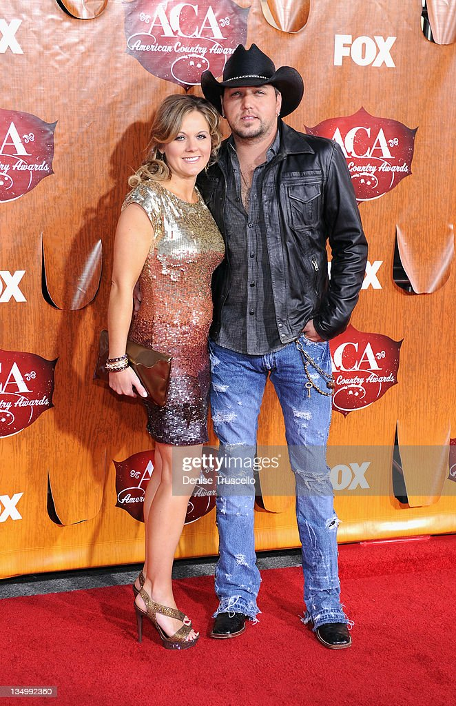 Musician <a gi-track='captionPersonalityLinkClicked' href=/galleries/search?phrase=Jason+Aldean&family=editorial&specificpeople=619221 ng-click='$event.stopPropagation()'>Jason Aldean</a> (R) and Jessica Aldean arrives at 2011 American Country Awards at MGM Grand Garden Arena on December 5, 2011 in Las Vegas, Nevada.