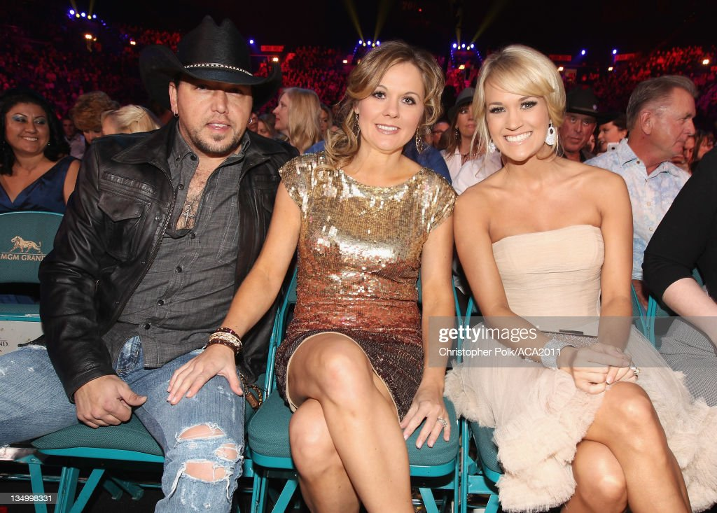 Musician <a gi-track='captionPersonalityLinkClicked' href=/galleries/search?phrase=Jason+Aldean&family=editorial&specificpeople=619221 ng-click='$event.stopPropagation()'>Jason Aldean</a>, Jessica Aldean and Singer <a gi-track='captionPersonalityLinkClicked' href=/galleries/search?phrase=Carrie+Underwood&family=editorial&specificpeople=204483 ng-click='$event.stopPropagation()'>Carrie Underwood</a> attends the American Country Awards 2011 at the MGM Grand Garden Arena on December 5, 2011 in Las Vegas, Nevada.