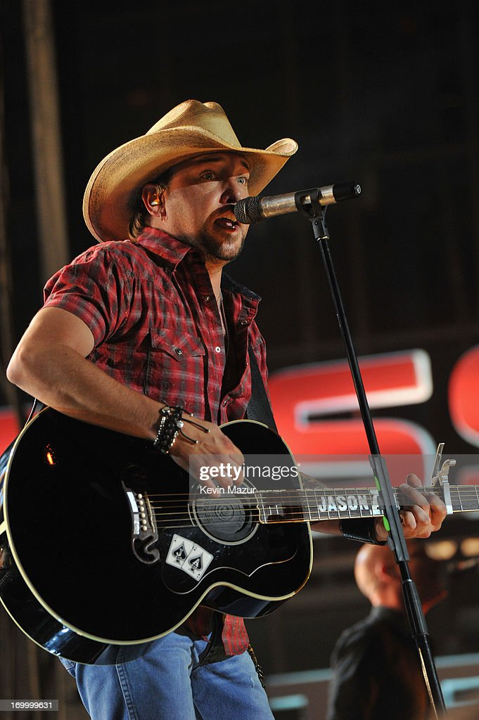 Musician Jason Aldean performs during the 2013 CMT Music awards at the Bridgestone Arena on June 5, 2013 in Nashville, Tennessee.