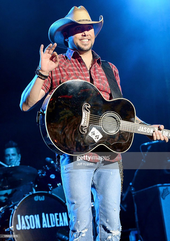Musician <a gi-track='captionPersonalityLinkClicked' href=/galleries/search?phrase=Jason+Aldean&family=editorial&specificpeople=619221 ng-click='$event.stopPropagation()'>Jason Aldean</a> performs onstage at the 2013 CMT Music Awards at the Bridgestone Arena on June 5, 2013 in Nashville, Tennessee.
