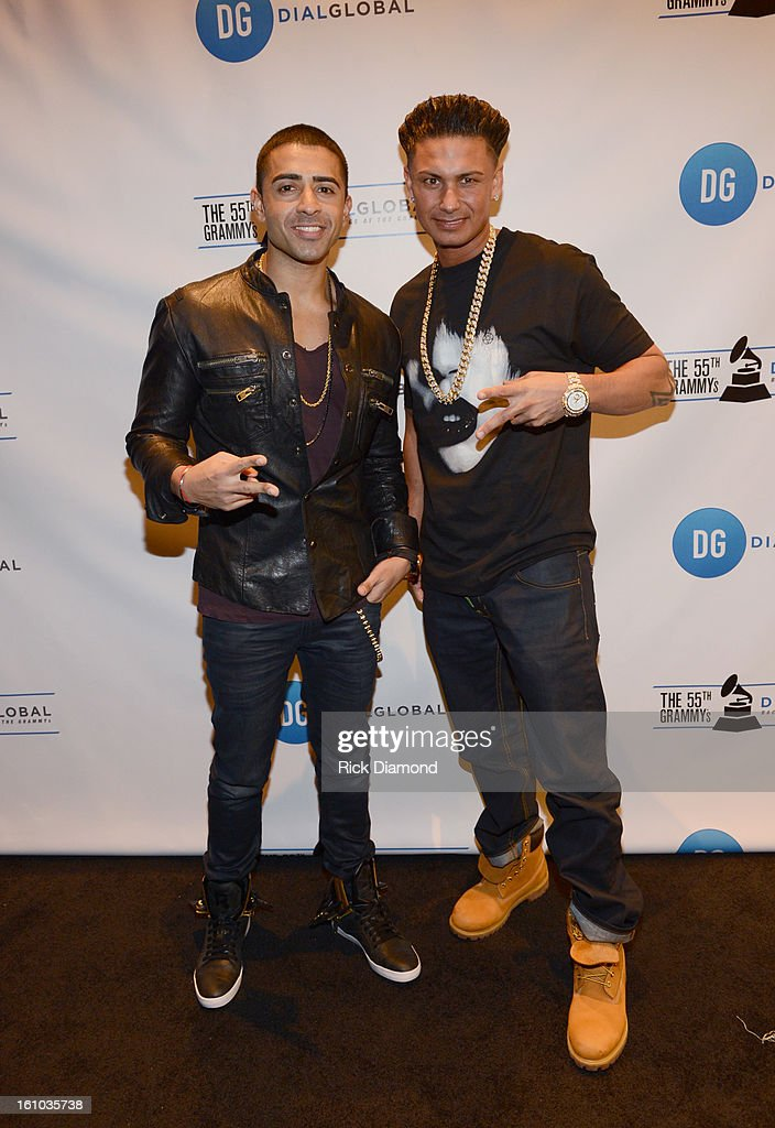 Musician Jay Sean (L) and television personality DJ Paul 'Pauly D' DelVecchio pose backstage at the GRAMMYs Dial Global Radio Remotes during The 55th Annual GRAMMY Awards at the STAPLES Center on February 8, 2013 in Los Angeles, California.