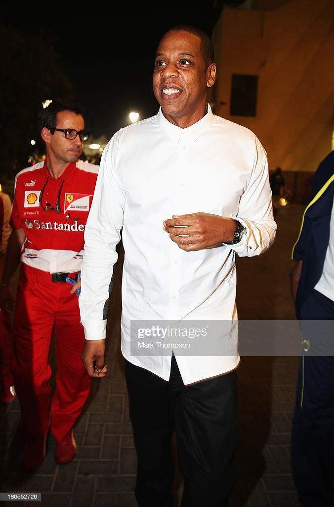 Musician Jay Z arrives in the F1 paddock following practice for the Abu Dhabi Formula One Grand Prix at the Yas Marina Circuit on November 1, 2013 in Abu Dhabi, United Arab Emirates.