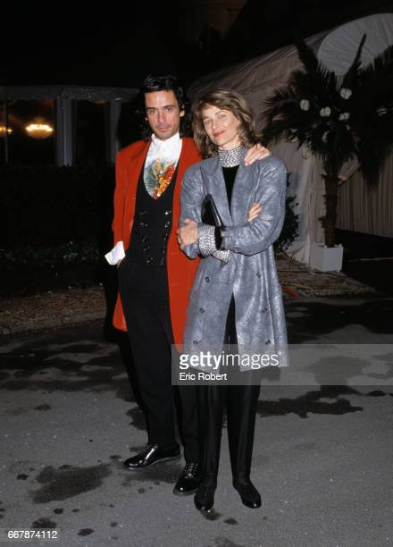 Musician JeanMichel Jarre and actress Charlotte Rampling arrive at Elton John's birthday party at Pre Catelan