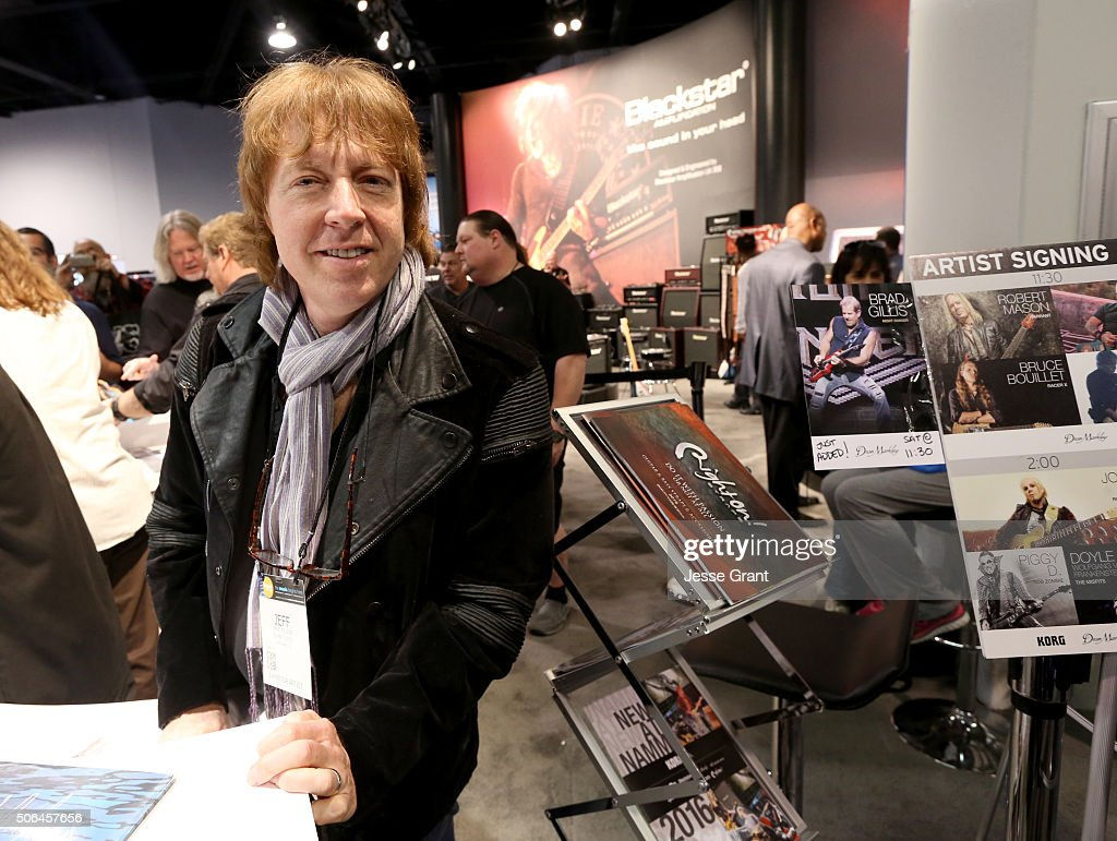 Musician Jeff Pilson signs autographs during day 3 of the 2016 NAMM Show at the Anaheim Convention Center on January 23 2016 in Anaheim California