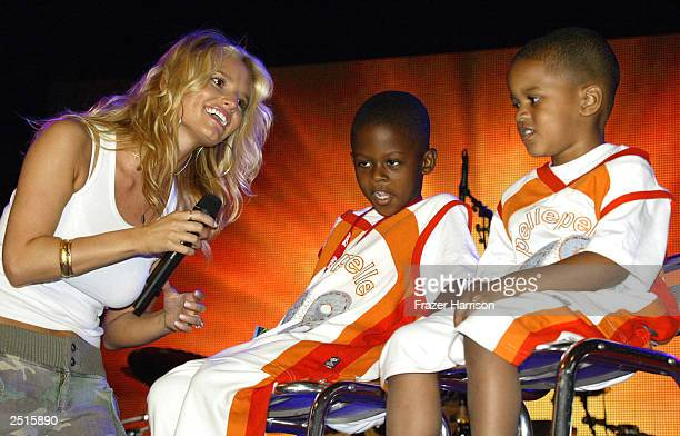 Musician Jessica Simpson sings to Shaquille O'Neal sons Myles and Shareef while on stage at the Athletes and Entertainers for Kids 'Shaqtacular VIII'...