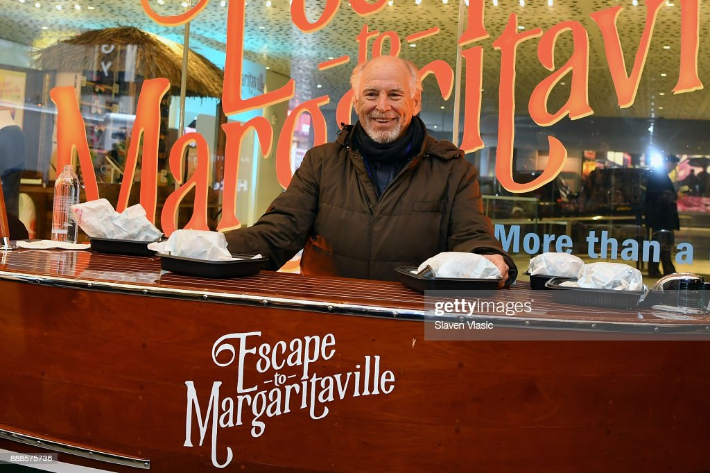 Musician Jimmy Buffett helps open Box Office for 'Escape To Margaritaville' on Broadway at Marquis Theatre on December 8, 2017 in New York City.