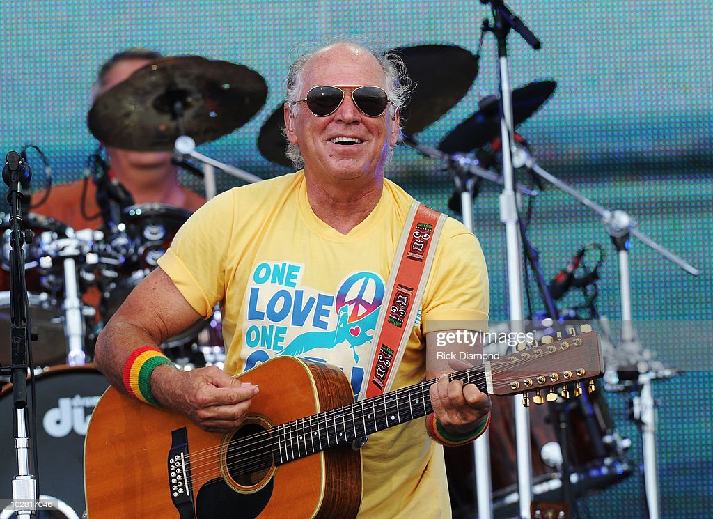 Musician Jimmy Buffett performs onstage at Jimmy Buffett & Friends: Live from the Gulf Coast, a concert presented by CMT at on the beach on July 11, 2010 in Gulf Shores, Alabama.