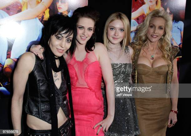 Musician Joan Jett actress Kristen Stewart actress Dakota Fanning and musician Cherie Currie arrive at the Los Angeles Premiere of The Runaways...