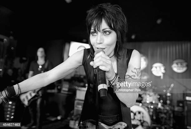 Musician Joan Jett performs at The ALTimate Rooftop Christmas Party at W Hollywood on December 9 2013 in Hollywood California