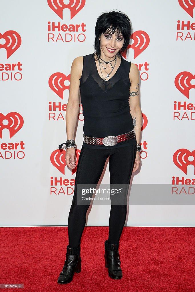 Musician Joan Jett poses in the iHeartRadio music festival photo room on September 21, 2013 in Las Vegas, Nevada.