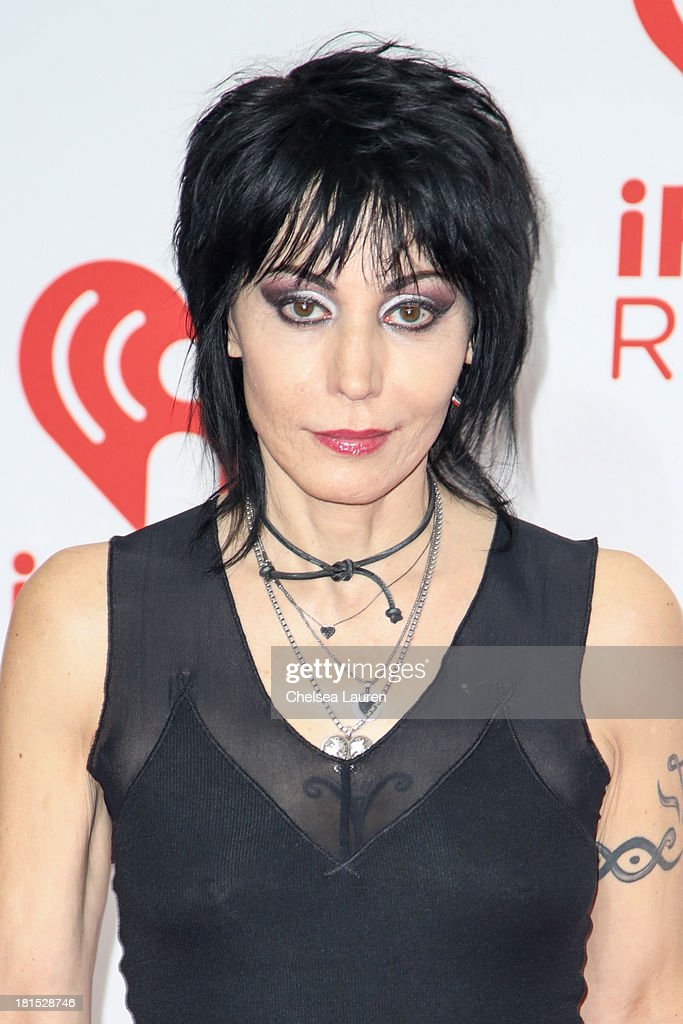 Musician <a gi-track='captionPersonalityLinkClicked' href=/galleries/search?phrase=Joan+Jett&family=editorial&specificpeople=213317 ng-click='$event.stopPropagation()'>Joan Jett</a> poses in the iHeartRadio music festival photo room on September 21, 2013 in Las Vegas, Nevada.