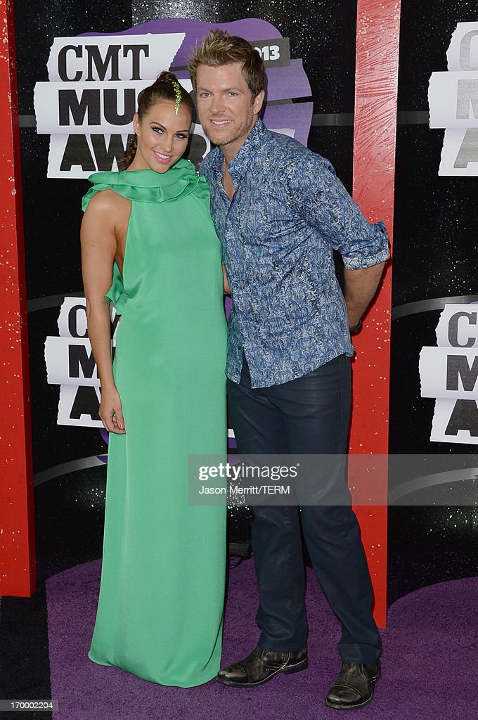 Musician Joe Don Rooney (R) and wife Tiffany Fallon attend the 2013 CMT Music awards at the Bridgestone Arena on June 5, 2013 in Nashville, Tennessee.