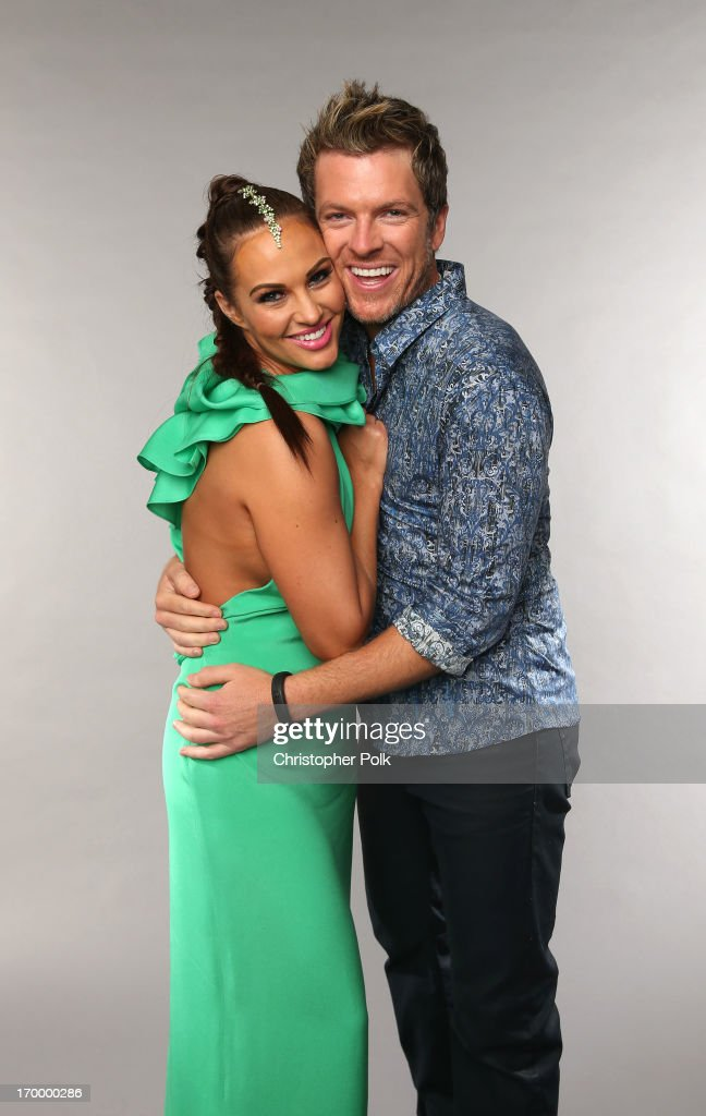 Musician Joe Don Rooney and wife Tiffany Fallon pose at the Wonderwall portrait studio during the 2013 CMT Music Awards at Bridgestone Arena on June 5, 2013 in Nashville, Tennessee.