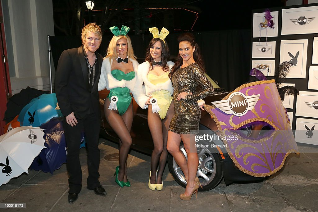 Musician Joe Don Rooney (L) of Rascal Flatts and Tiffany Fallon (R) pose with Playmates at The Playboy Party Presented by Crown Royal on February 1, 2013 in New Orleans, Louisiana.