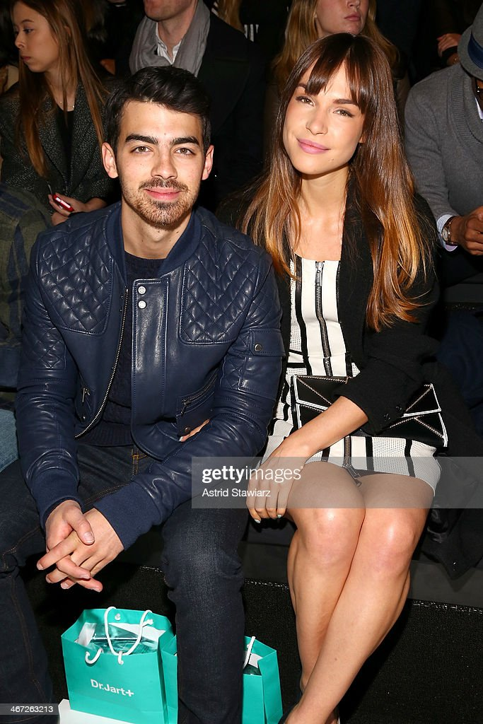 Musician <a gi-track='captionPersonalityLinkClicked' href=/galleries/search?phrase=Joe+Jonas&family=editorial&specificpeople=842712 ng-click='$event.stopPropagation()'>Joe Jonas</a> (L) and Blanda Eggenschwiler attend Richard Chai fashion show during Mercedes-Benz Fashion Week Fall 2014 at The Salon at Lincoln Center on February 6, 2014 in New York City.