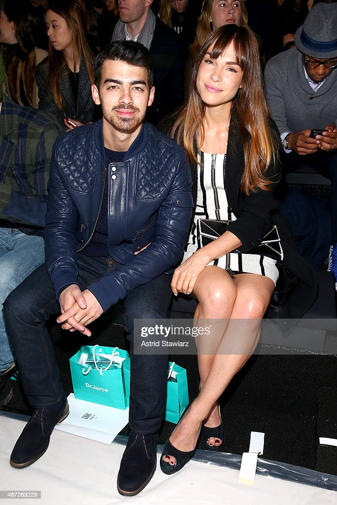 Musician <a gi-track='captionPersonalityLinkClicked' href=/galleries/search?phrase=Joe+Jonas&family=editorial&specificpeople=842712 ng-click='$event.stopPropagation()'>Joe Jonas</a> (L) and <a gi-track='captionPersonalityLinkClicked' href=/galleries/search?phrase=Blanda+Eggenschwiler&family=editorial&specificpeople=7937749 ng-click='$event.stopPropagation()'>Blanda Eggenschwiler</a> attend Richard Chai fashion show during Mercedes-Benz Fashion Week Fall 2014 at The Salon at Lincoln Center on February 6, 2014 in New York City.