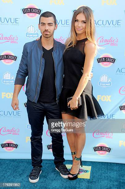 Musician Joe Jonas and guest arrive at the 2013 Teen Choice Awards at Gibson Amphitheatre on August 11 2013 in Universal City California
