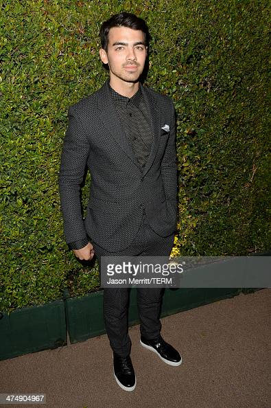 Musician Joe Jonas attends 'Decades of Glamour' presented by BVLGARI on February 25 2014 in West Hollywood California