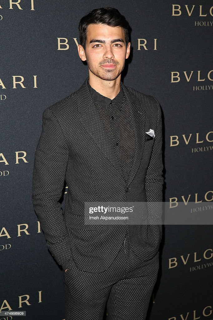 Musician <a gi-track='captionPersonalityLinkClicked' href=/galleries/search?phrase=Joe+Jonas&family=editorial&specificpeople=842712 ng-click='$event.stopPropagation()'>Joe Jonas</a> attends the BVLGARI 'Decades of Glamour' Oscar Party at Soho House on February 25, 2014 in West Hollywood, California.