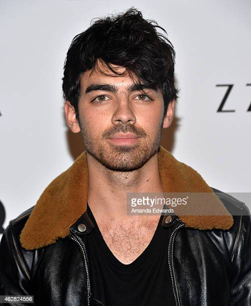 Musician Joe Jonas attends the Z Zegna GQ celebration of the new Z Zegna hosted by Nick Jonas at Philymack Inc on February 5 2015 in West Hollywood...