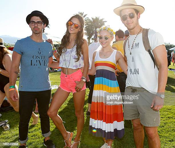 Musician Joe Jonas model Alessandra Ambrosio actress AnnaSophia Robb and musician Nick Jonas attend the FIJI Water At Lacoste LVE Coachella Desert...
