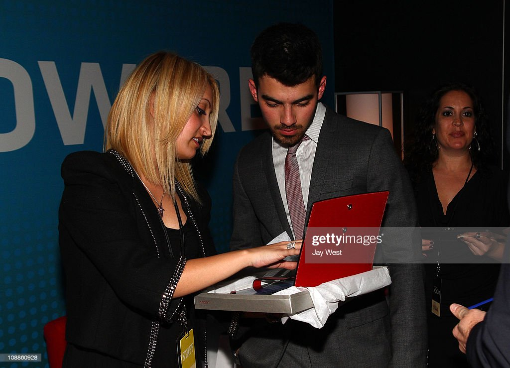 Musician Joe Jonas poses with Motorola Xoom at the Maxim Party Powered by Motorola Xoom at Centennial Hall at Fair Park on February 5, 2011 in Dallas, Texas.