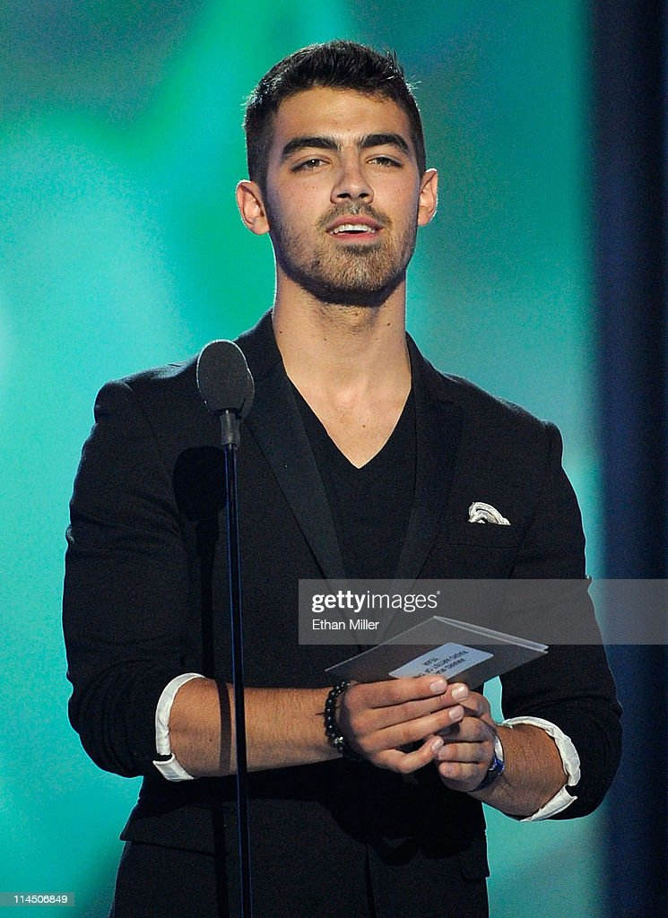 Musician <a gi-track='captionPersonalityLinkClicked' href=/galleries/search?phrase=Joe+Jonas&family=editorial&specificpeople=842712 ng-click='$event.stopPropagation()'>Joe Jonas</a> speaks onstage during the 2011 Billboard Music Awards at the MGM Grand Garden Arena May 22, 2011 in Las Vegas, Nevada.