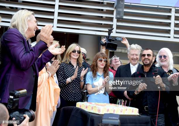 Musician Joe Walsh Barbara Bach singer Jenny Lewis director David Lynch musician Ringo Starr and Edgar Winter appear at the 'Peace Love' birthday...