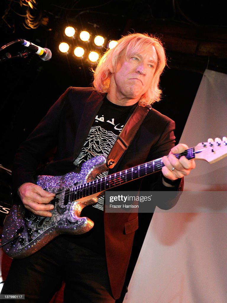 Musician <a gi-track='captionPersonalityLinkClicked' href=/galleries/search?phrase=Joe+Walsh+-+Singer&family=editorial&specificpeople=223888 ng-click='$event.stopPropagation()'>Joe Walsh</a> perform at the 'SiriusXM's Town Hall With Ringo Starr' And Host Russell Brand And Moderator Don Was Live On SiriusXM's The Spectrum Channel performs at Troubadour on January 30, 2012 in West Hollywood, California.