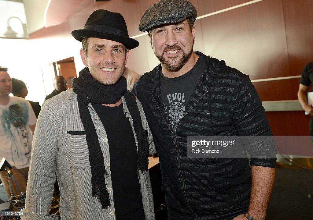 Musician Joey McIntyre and musician/actor Joey Fatone pose backstage at the GRAMMYs Dial Global Radio Remotes during The 55th Annual GRAMMY Awards at...
