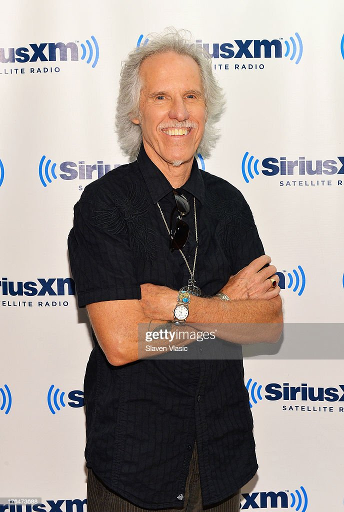 Musician <a gi-track='captionPersonalityLinkClicked' href=/galleries/search?phrase=John+Densmore&family=editorial&specificpeople=926933 ng-click='$event.stopPropagation()'>John Densmore</a>, the drummer of 'The Doors' visits SiriusXM Studios on August 13, 2013 in New York City.