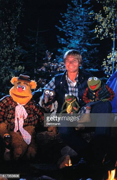 Musician John Denver poses with the Muppets during an episode of the Muppet Show From left are Fozzie Bear Gonzo John Denver and Kermit the Frog