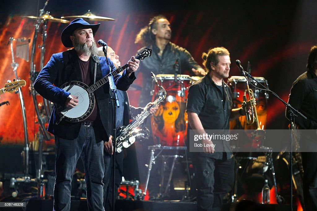 Musician John Driskell Hopkins (L) of Zac Brown Band performs onstage during the 2016 iHeartCountry Festival at The Frank Erwin Center on April 30, 2016 in Austin, Texas.