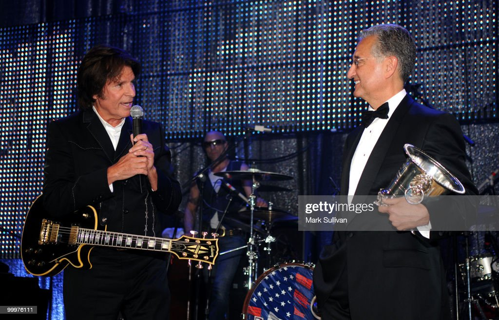 Musician John Fogerty and BMI President and CEO Del Bryant speak onstage during the 58th Annual BMI Pop Awards held at the Beverly Wilshire Hotel on May 18, 2010 in Beverly Hills, California.