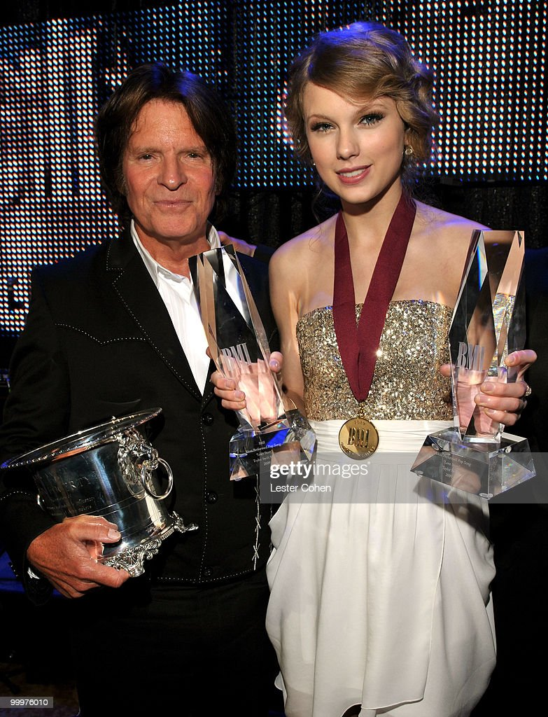 Musician John Fogerty and musician Taylor Swift pose at the 58th Annual BMI Pop Awards held at the Beverly Wilshire Hotel on May 18, 2010 in Beverly Hills, California.