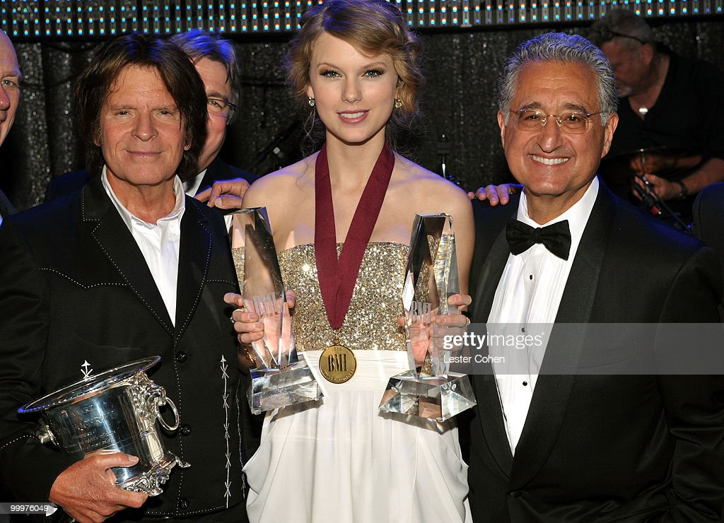 Musician John Fogerty, musician Taylor Swift and BMI President and CEO Del Bryant pose during the 58th Annual BMI Pop Awards held at the Beverly Wilshire Hotel on May 18, 2010 in Beverly Hills, California.