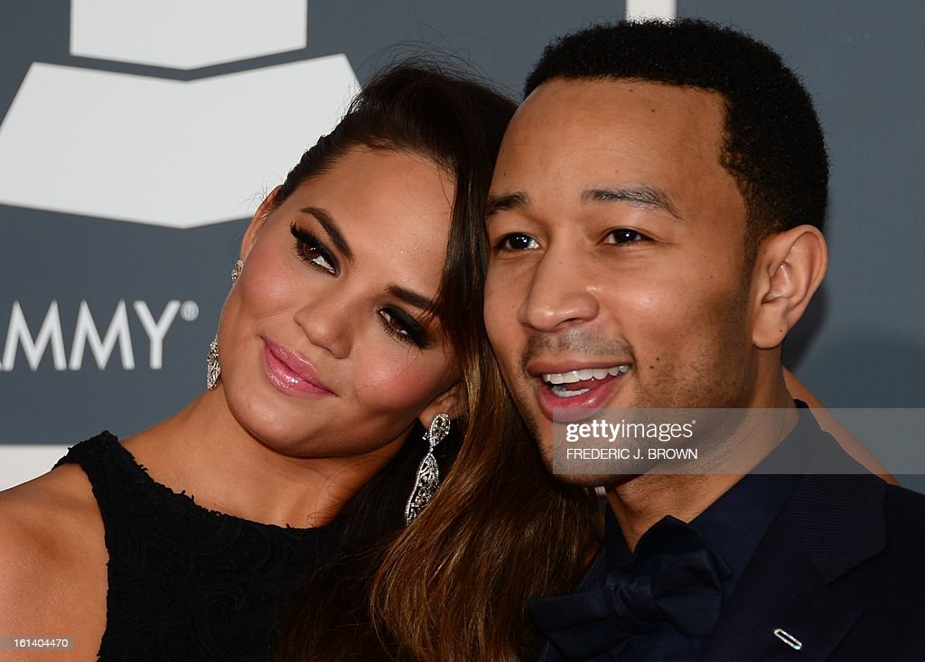 Musician John Legend and Chrissy Teigen arrive on the red carpet at the Staples Center for the 55th Grammy Awards in Los Angeles, California, February 10, 2013. AFP PHOTO Frederic J. BROWN