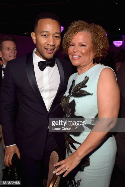 Musician John Legend and honoree Debra Lee attend PreGRAMMY Gala and Salute to Industry Icons Honoring Debra Lee at The Beverly Hilton on February 11...