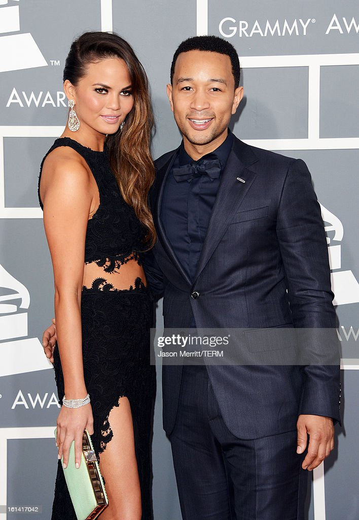 Musician John Legend (R) and model Chrissy Teigen arrive at the 55th Annual GRAMMY Awards at Staples Center on February 10, 2013 in Los Angeles, California.