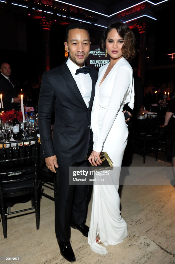Musician John Legend and model Christine Teigen attend the amfAR New York Gala to kick off Fall 2013 Fashion Week at Cipriani Wall Street on February 6, 2013 in New York City.