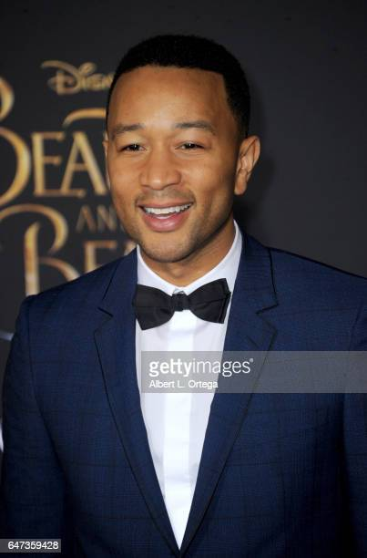Musician John Legend arrives for the Premiere Of Disney's 'Beauty And The Beast' held at El Capitan Theatre on March 2 2017 in Los Angeles California