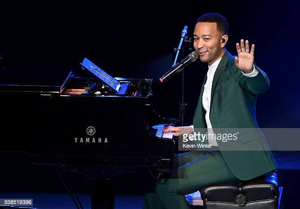 Musician John Legend performs onstage during the 'Hillary Clinton She's With Us' concert at The Greek Theatre on June 6 2016 in Los Angeles California