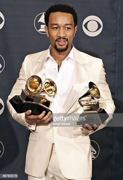 Musician John Legend with his award for Best RB Album and Best RB Vocal Performance poses in the press room at the 48th Annual Grammy Awards at the...