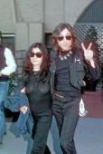 Musician John Lennon and his wife artist Yoko Ono walk down the street in circa 1979 in New York City New York